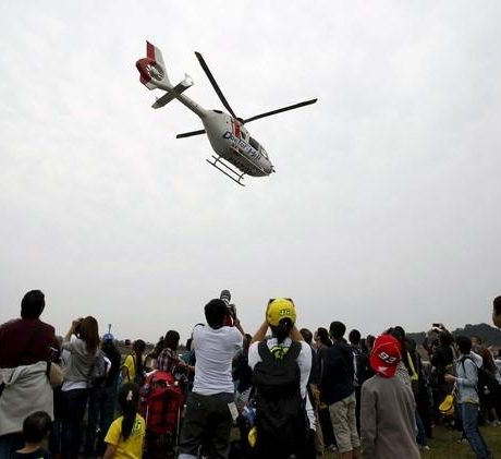 A medical helicopter carries Angelis in Motegi